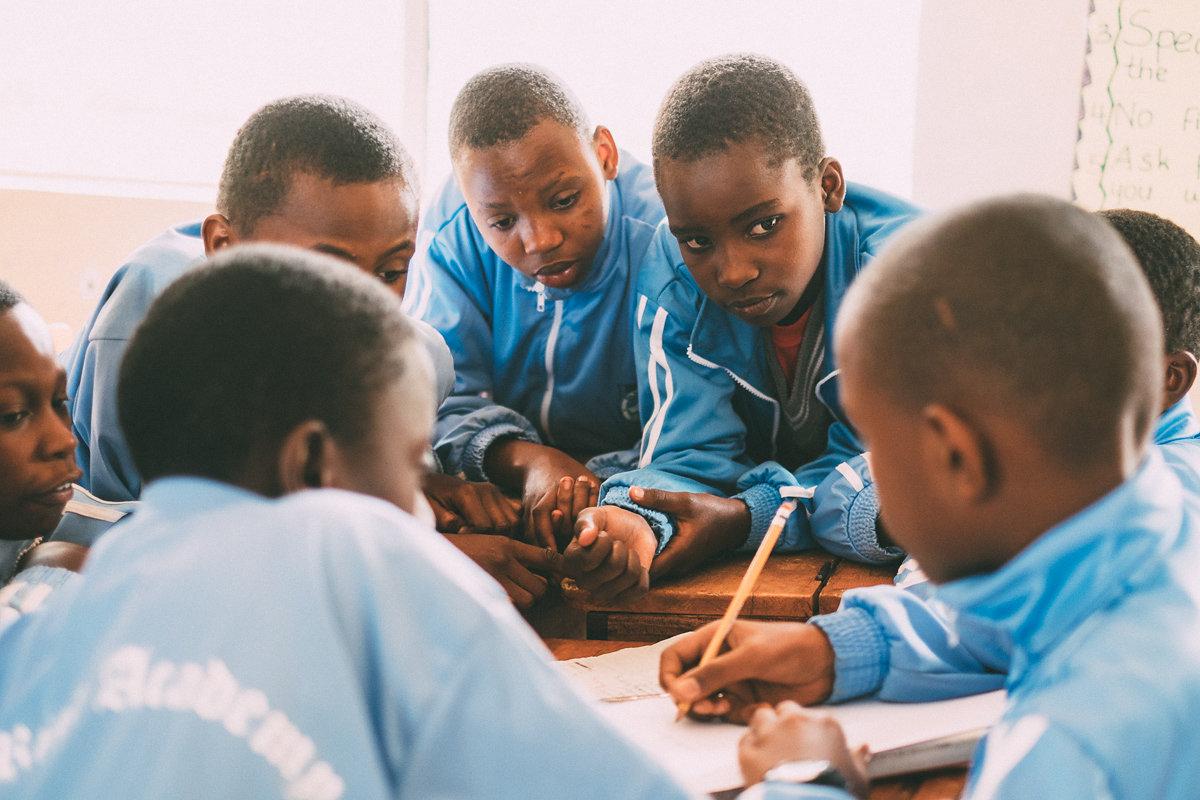 URA kids teamwork in classroom